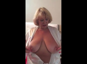Blond mature Plumper flashes her..