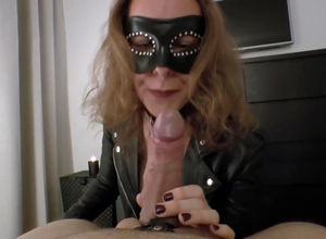 Mature domme in the mask blowing her..