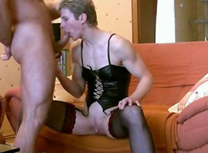 Short-haired vicious mature dame gives..