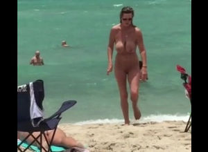Totally nude lady naturist with fat..