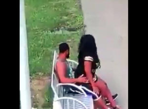 Dark-hued duo smashes on park bench..