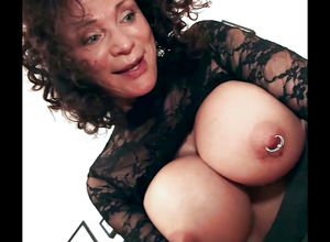 Playful grandma with phat pierced jugs..