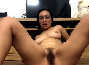 Mischievous chinese mature plays with..