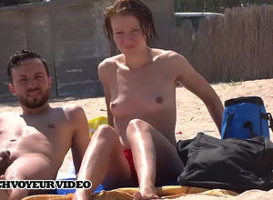 Nudist couple noticed they were being..