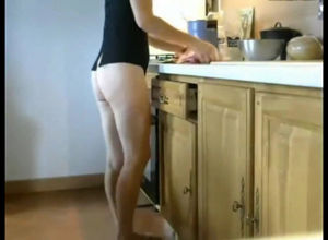 Long-legged mature mother cooking with..