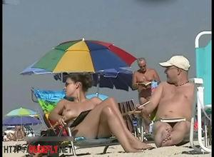 Big-titted damsel sunbathing in a bare..