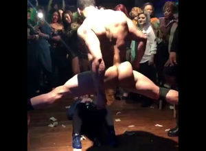 Beefy masculine stripper dancing in..