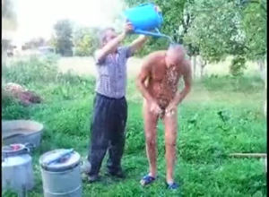 Mature daddy takes douche naked outdoor